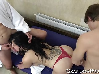 chubby granny fucks two guys and eats warm cum